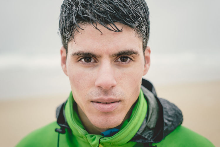 Close-up portrait of man during rainy season