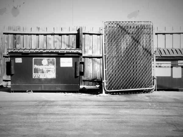 Dumpster Monochrome Photography Outdoors Blackandwhite Light And Shadow Darkness And Light Notes From The Underground Random Acts Of Photography Streetphotography Chainlink Fence Urban Exploration Trash Garbage Fence Unwanted Discarded Deterioration Dirty Florida The Unknown Still Life The Purist (no Edit, No Filter) Floridaphotographer Beauty Of Decay Run-down