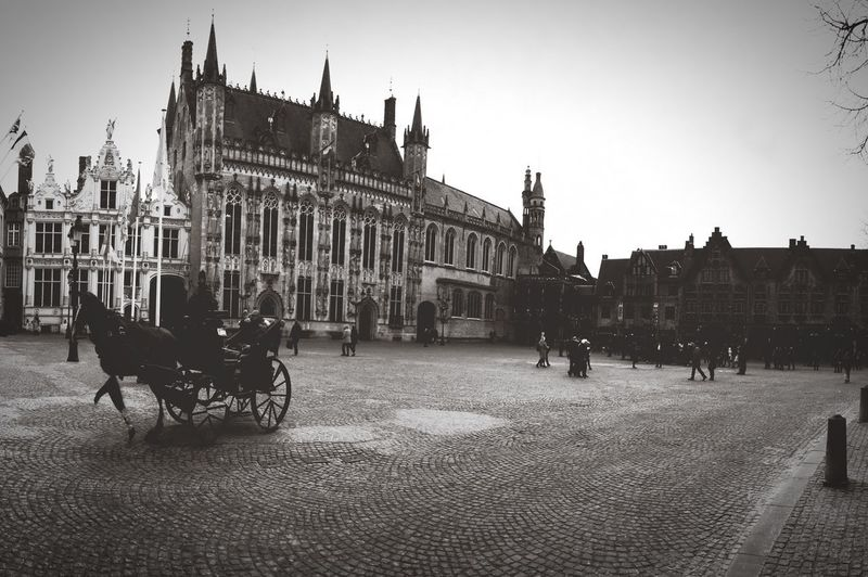 I jump in the past! in the early twentieth century, could Bruges be like this? 🤗🤔 EyeEmNewHere EyeEm Best Shots Blackandwhite Twentieth Brugge Brugge, Belgium Building Exterior Architecture Built Structure Sky Crowd Group Of People City Travel Destinations Transportation Large Group Of People Travel Building Tourism Day Nature Mode Of Transportation Real People Clear Sky Land Vehicle Men EyeEmNewHere The Traveler - 2018 EyeEm Awards The Architect - 2018 EyeEm Awards