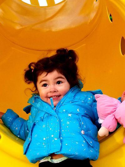 Girl enjoying in slide