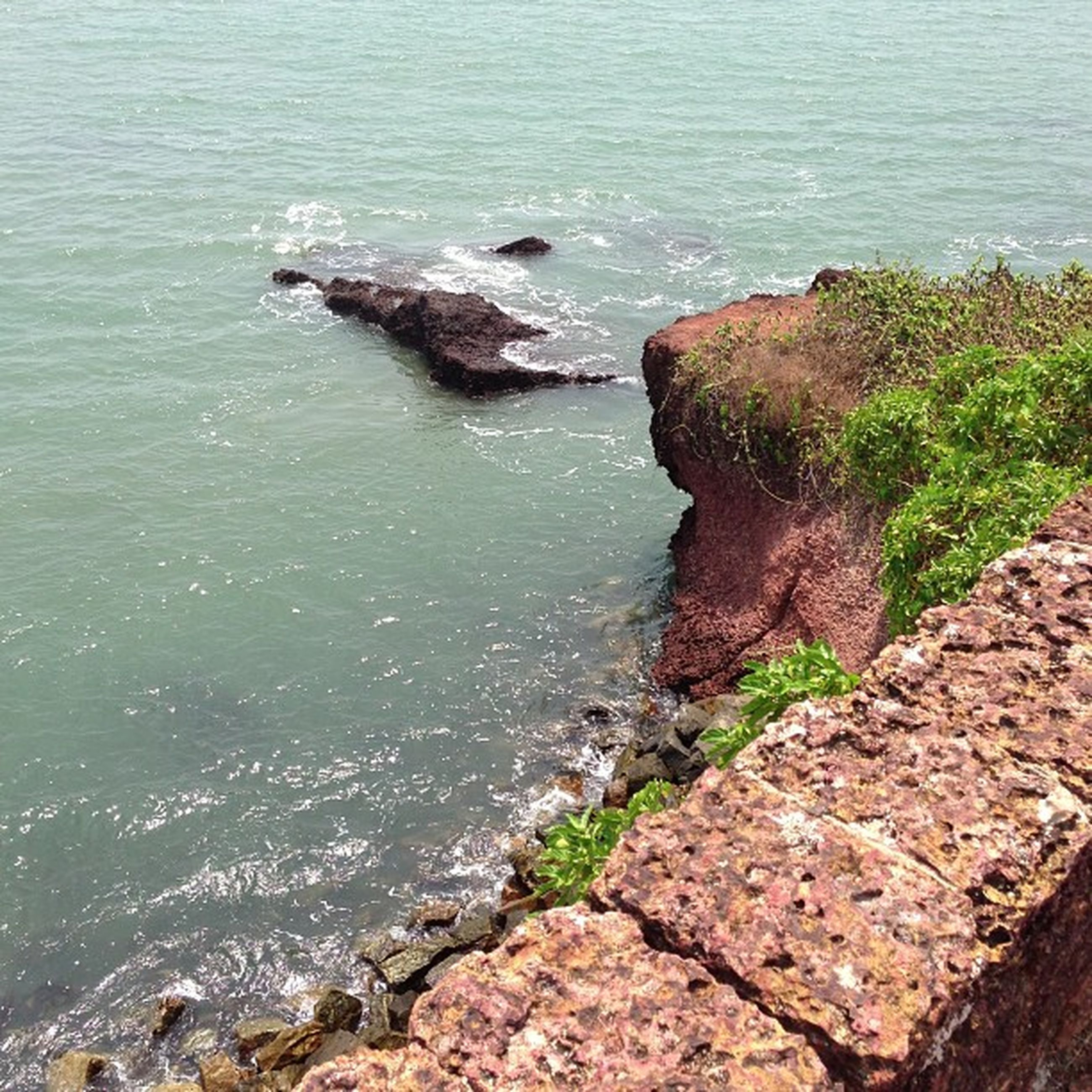 water, sea, rock - object, high angle view, tranquility, tranquil scene, nature, beauty in nature, scenics, rock formation, rock, rippled, coastline, shore, cliff, day, horizon over water, idyllic, no people, outdoors