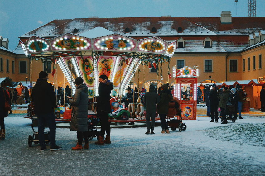Real People Winter Street Streetphotography Street Scene Urban Scene Carousel Christmas Market Full Length Christmas Decoration Market Amusement Park Women Illuminated Architecture Built Structure Carousel Horses Merry-go-round Christmas Lights Christmas Holiday Moments A New Perspective On Life