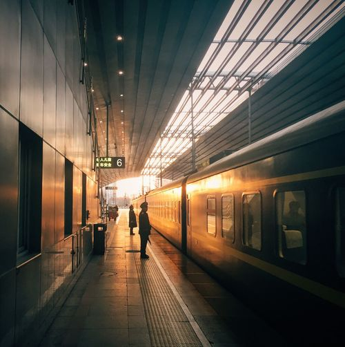 Departure at sunset China Photos Beijing Train Station Railway Showcase March Sunlight Sunset Train On The Way