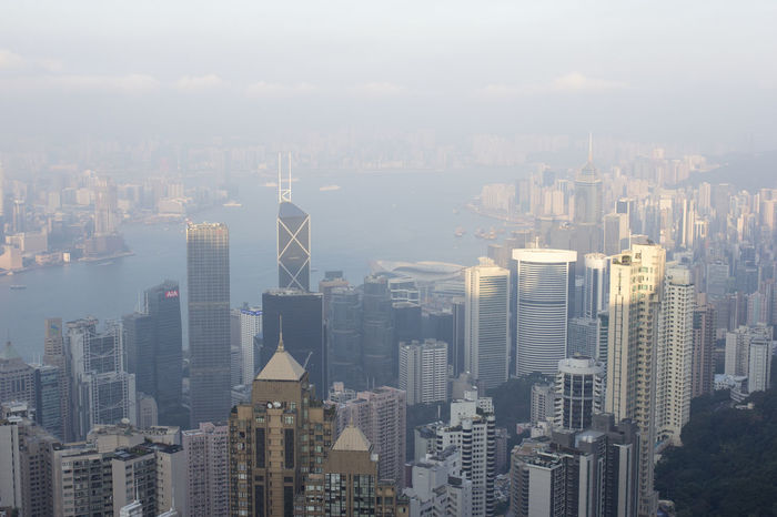Asian Cities Colour Your Horizn Hk Hong Kong Hong Kong City Modern Architecture Skyscrapers Architecture Building Exterior China City Cityscape Day Densely Built Downtown Downtown District Haze Highrise Hong Kong Island Modern No People Outdoors Skyscraper Sunset Urban Skyline