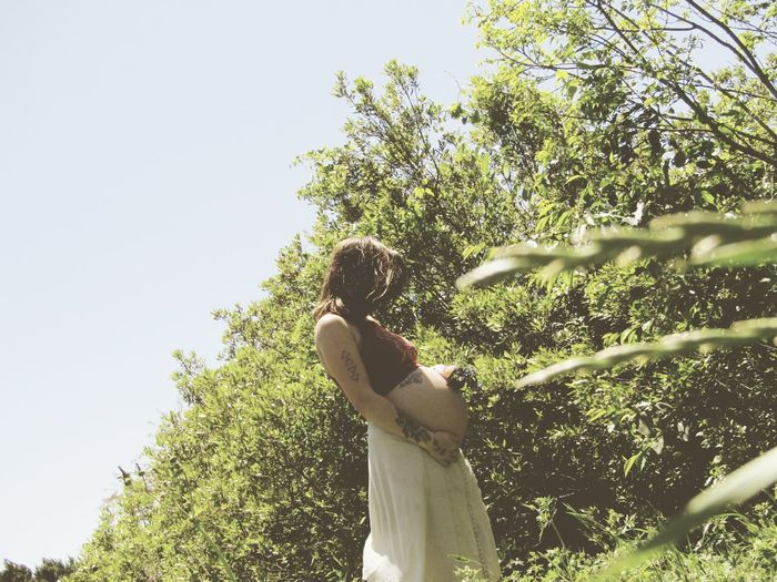 Tree Spraying Sky Female Likeness Statue Virgin Mary Growing