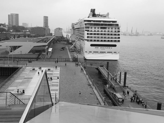 Black And White Cruise Ship City Building Exterior Built Structure Architecture Water Transportation Mode Of Transportation High Angle View