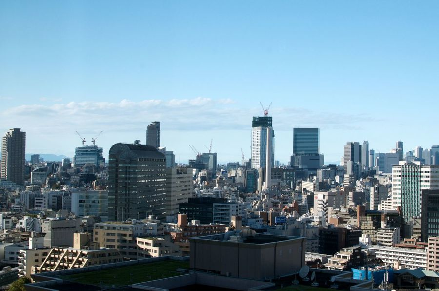A section of the Tokyo Skyline as viewed from a high rise in Ebisu, Tokyo, Japan Architecture Cityscape Office Building Exterior Urban Skyline Skyscraper No People City Construction Urban Development Copy Space Travel Japan Financial District  Blue Sky Sunny Day