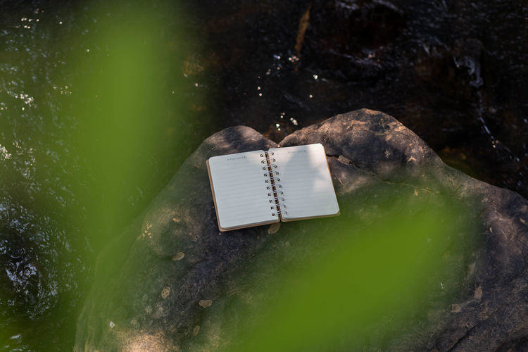 Close-up of open book on rock