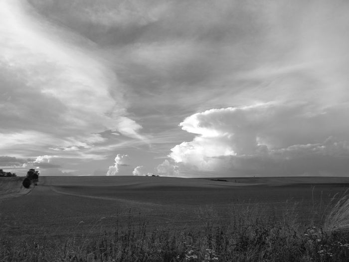 Landscape b&w Landscape Landschaften Tranquility Landscape Tranquil Scene Sky Cloud - Sky Scenics Travel Destinations Field Nature Beauty In Nature Day Solitude Tourism Cloudscape Distant Cloudy Non-urban Scene Rural Scene Vacations Surface Level