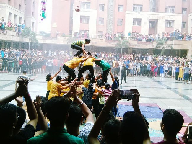 The Color Of Sport Large Group Of People Architecture Building Exterior Sitting City Life Togetherness Crowd Human Pyramid  Illuminated In Front Of Social Gathering Enjoyment Outdoors Spectator Janmashtami Indianstories Festival Matkifod Pot