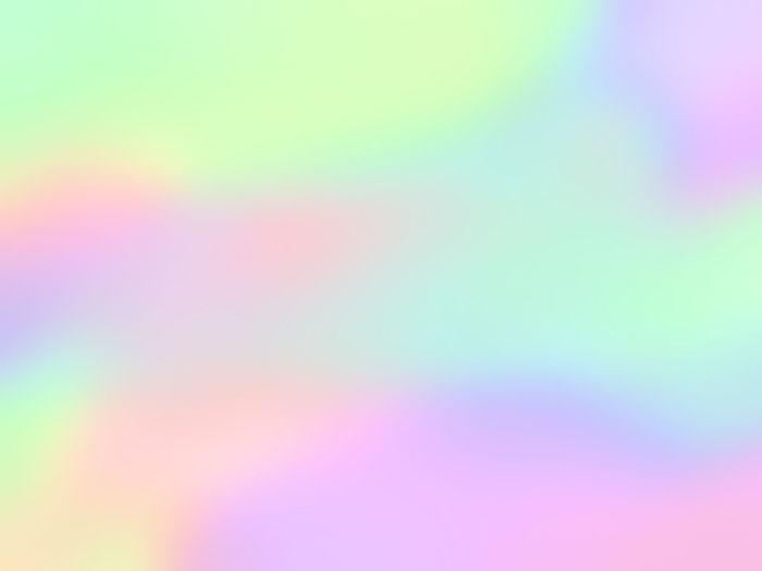 Defocused image of illuminated pink yellow background