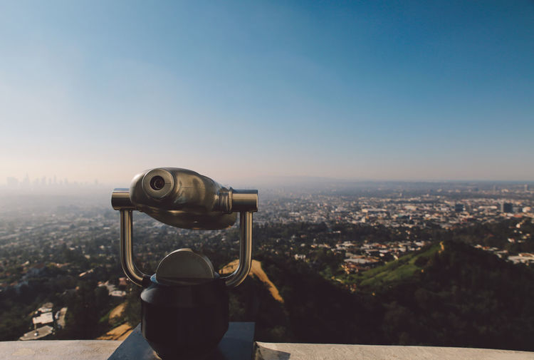 Close-Up Of Coin-Operated Binoculars On Retaining Wall Over Cityscape At Griffith Point Observatory