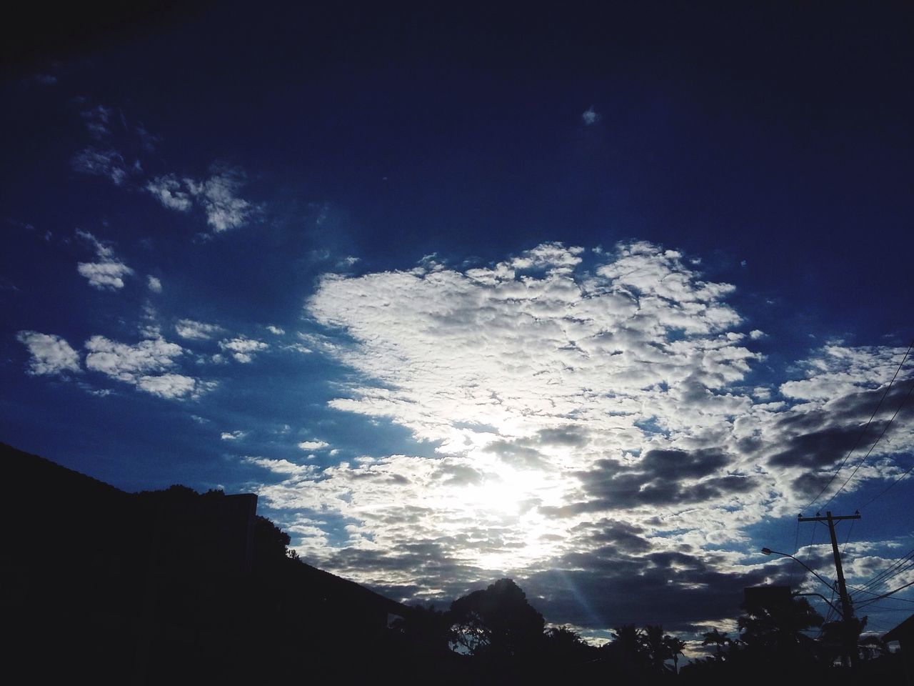 low angle view, sky, nature, beauty in nature, silhouette, no people, outdoors, tranquility, day, scenics, tree, astronomy