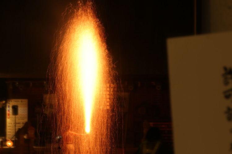 View of illuminated fire at night