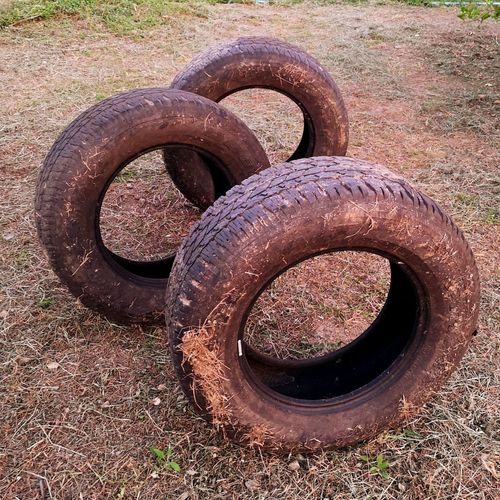 High angle view of old rusty wheel on field