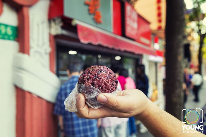 Chinese black sticky rice ball Human Hand Real People Food And Drink Human Body Part One Person Holding Food Focus On Foreground Lifestyles Building Exterior Personal Perspective Outdoors Freshness Architecture Built Structure Day Leisure Activity Close-up People Young Studio Breakfast Shanghai Cuisine Rice Ball Black Sticky Rice