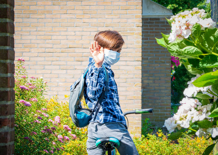 A school boy back to school with mask after pandemic coronavirus