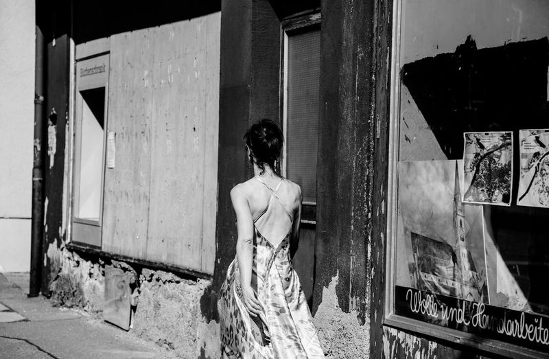 Women One Person Rear View Real People Standing Lifestyles Leisure Activity Architecture Women Built Structure Clothing Adult Building Exterior Day Three Quarter Length Young Adult Door Dress Hairstyle Entrance Outdoors