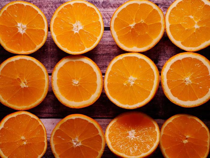 Orange Color Food And Drink Citrus Fruit Food Healthy Eating Fruit Wellbeing Orange - Fruit Orange Cross Section SLICE Freshness No People Close-up Full Frame In A Row Arrangement Indoors  Still Life Directly Above