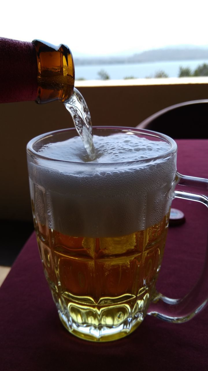 drink, refreshment, food and drink, close-up, drinking glass, focus on foreground, table, freshness, alcohol, beer, no people, beer - alcohol, beer glass, frothy drink, day, indoors, sky