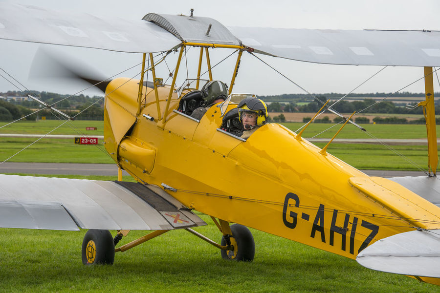 Tiger Moth during take off Field Manoeuvre Natural Take Off! Tiger Moth Air Vehicle Airplane Biplane Close-up Day Detail Field Grass Historic Old Outdoors Pilot Positioning Propeller Propeller Blur Spinning Take Off & Landing Transportation Vintage Yellow
