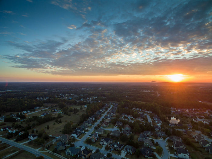 Aerial view of town against sky during sunset