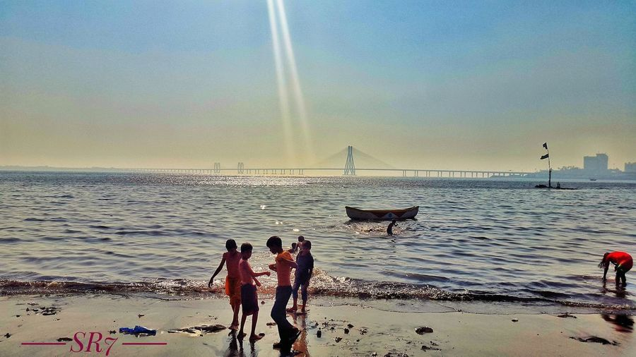 Sea Beach Horizon Over Water Beauty In Nature Nature Sky Sand Wave Vacations Water Outdoors Silhouette Scenics Large Group Of People Real People Men Day Nautical Vessel People Architecture Bridge - Man Made Structure Bandraworlisealink Mahim Dargah EyeEmNewHere