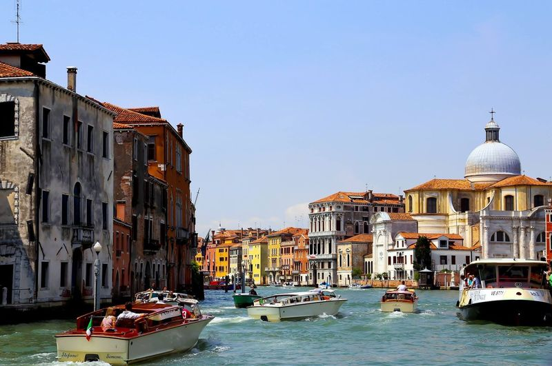 Boats sailing on grand canal