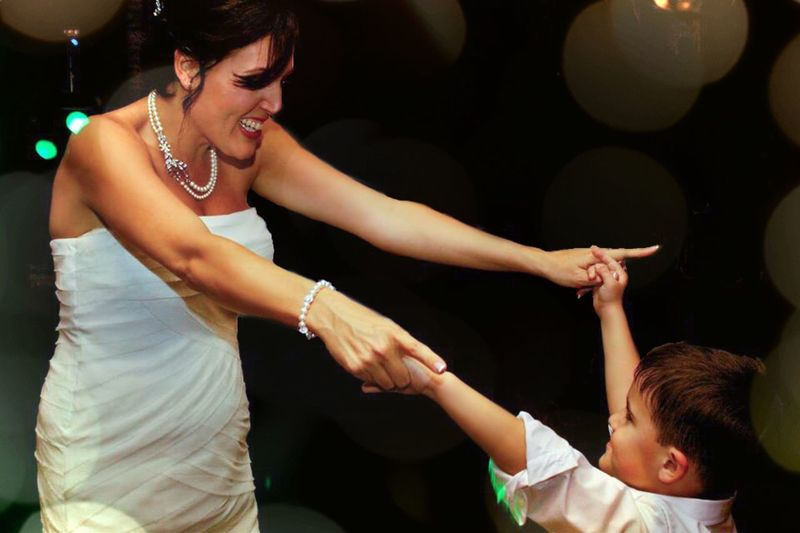 Mother and son dancing at party
