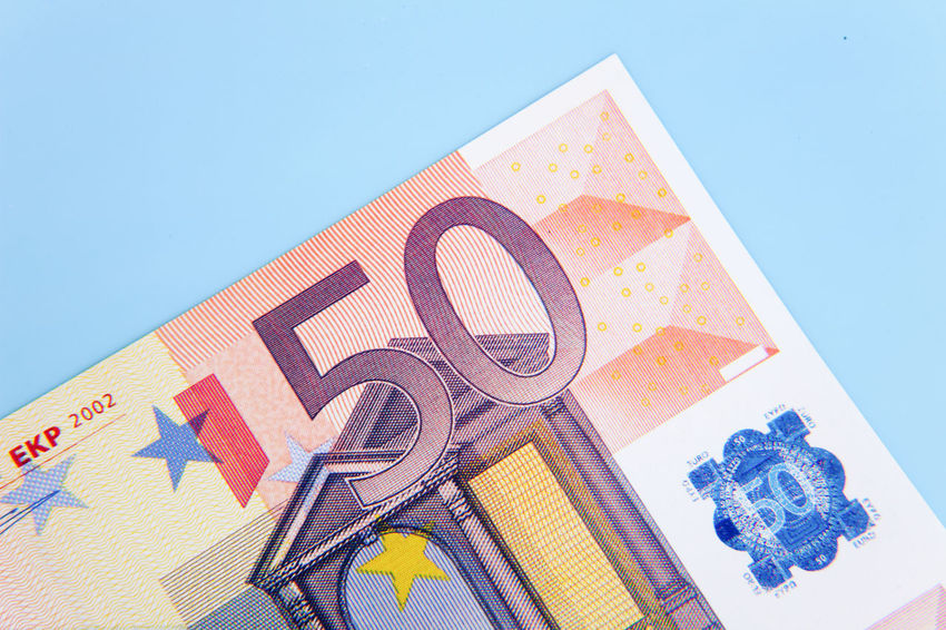 Fifty euro note on light blue background Banking Bonus Credit Currency Debit Euro Notes Euro Zone Financial Financial Planning Financial Service Make Money Money Money Money Money Premium Save Money Savings