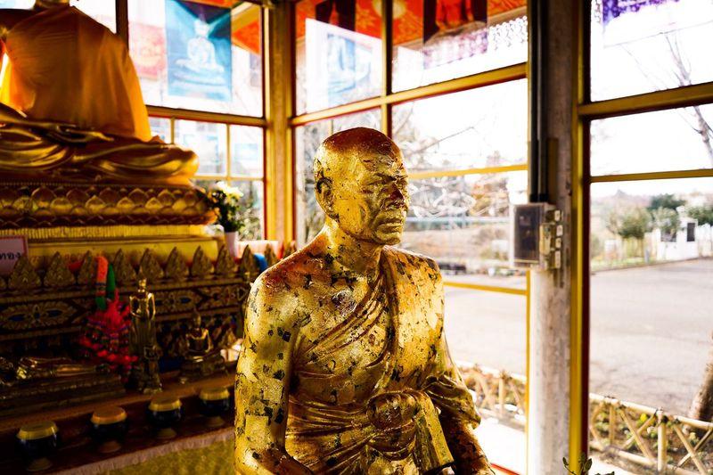 Statue against window