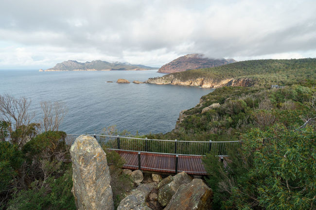 Cape Tourville Lookout, Tasmania Australia Coles Bay Lookout Beauty In Nature Cape Tourville Cliff Cloud - Sky Day Freycinet Freycinet National Park Horizon Over Water Landscape Mountain Nature No People Outdoors Scenics Sea Sky Tasmania Tranquil Scene Tranquility Travel Destinations Walkway Water
