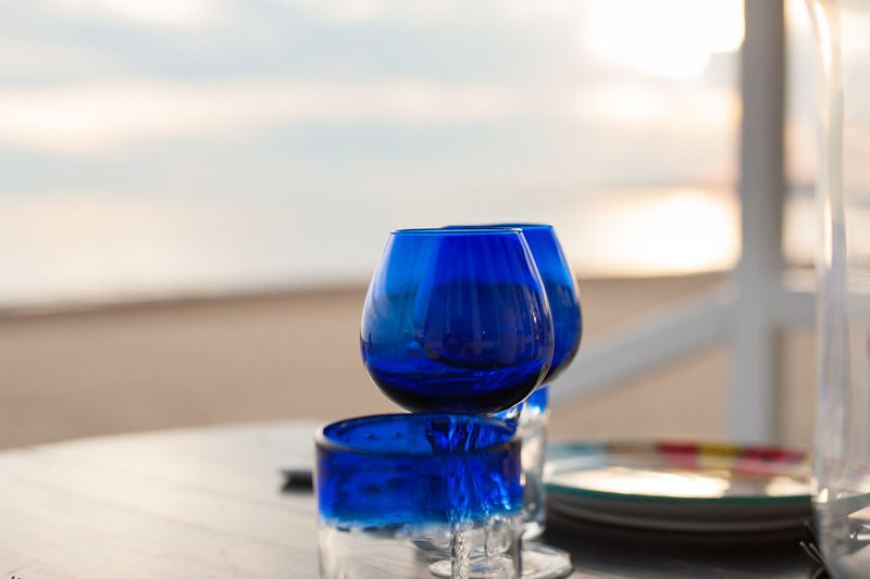 Close-Up Of Wineglasses On Table Beach
