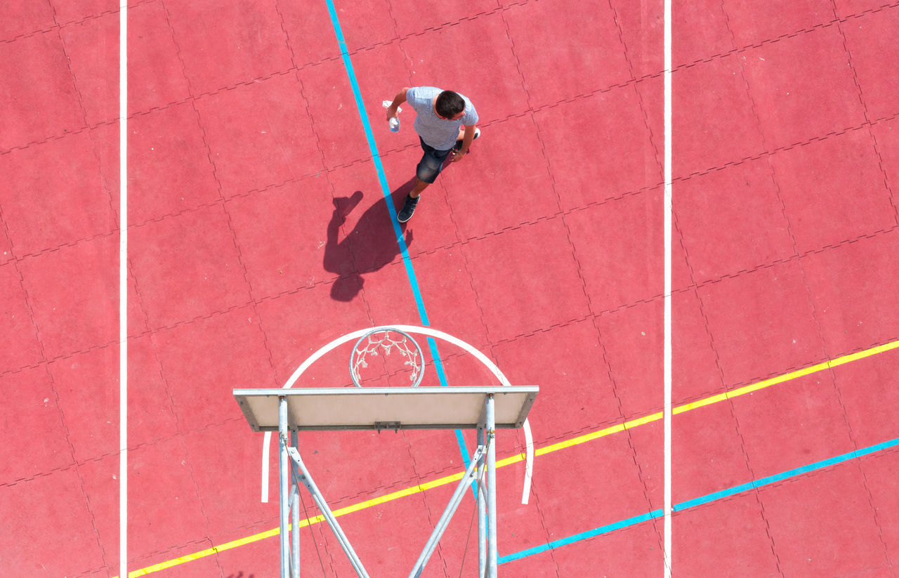 High angle view of person walking on basketball court