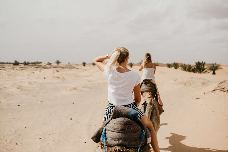 Desert Dunes Freedom Friends Happiness Morocco NOMAD Nature Run Running Travel Vacations Beauty Beauty In Nature Best Friends Camel Riding Desert Beauty Friendship Laughter Sahara Sand Dune Travel Destinations Women Young Adult Young Women