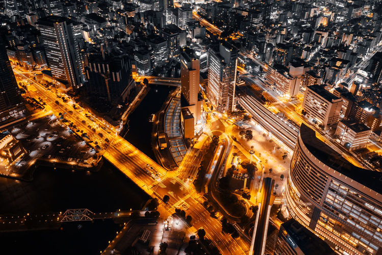 Aerial View Architecture Building Exterior Built Structure City City Life Cityscape Complexity Fuel And Power Generation High Angle View Illuminated Industry Long Exposure Modern Motion Night No People Office Building Exterior Road Skyscraper Street Technology Transportation
