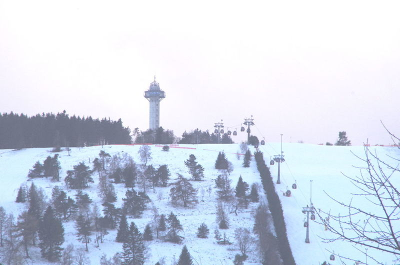 ettelsberg as seen from willingen Winter Cold Temperature Snow Architecture Built Structure Nature Sky Plant Building Exterior Tree Tower Day Clear Sky No People Covering Frozen Travel Destinations Outdoors Extreme Weather Blizzard Snowing Ettelsberg Willingen