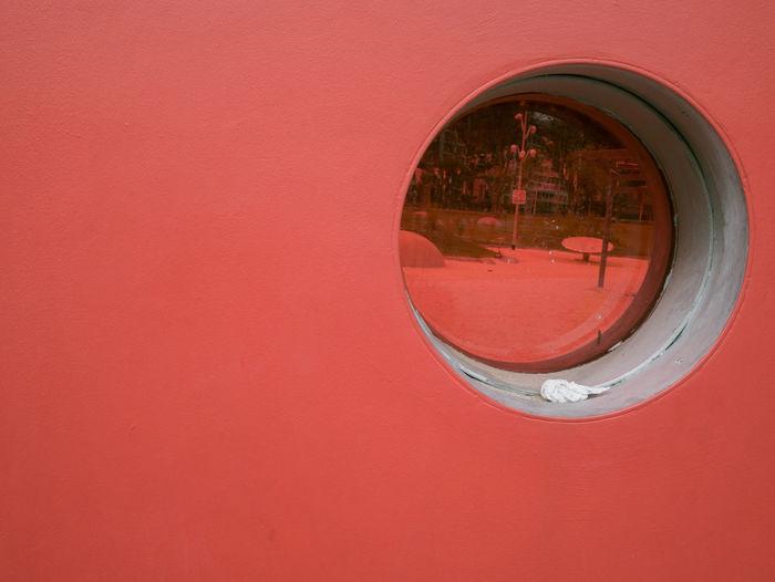 Close-up of red object on wall