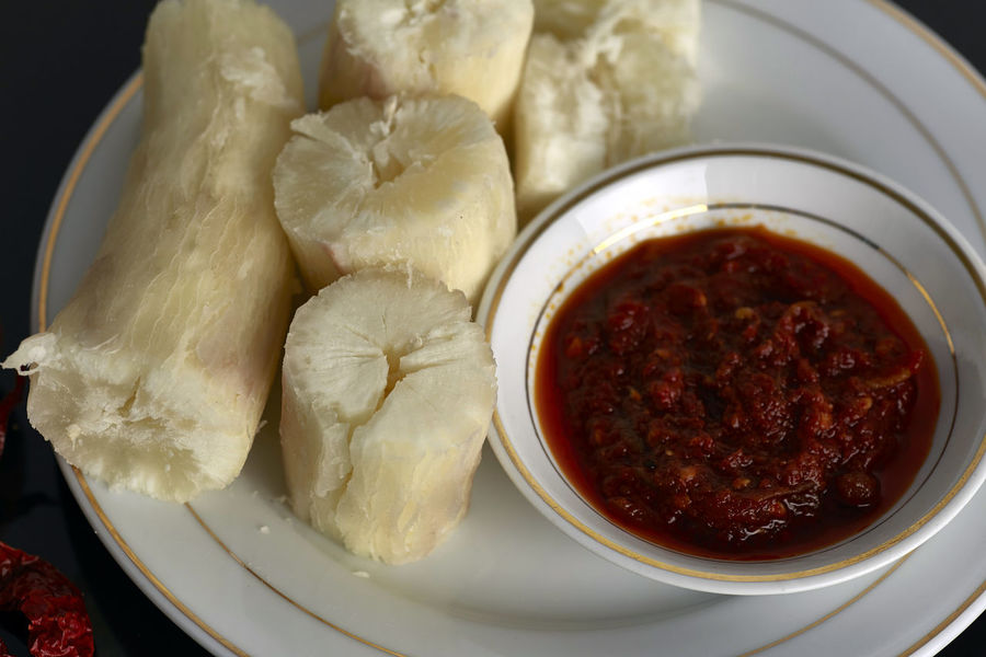 "steam tapioca with dipped sambal. In Malaysia this food called""Ubi Rebus"" one of traditional malay food cultural Hot Red Traditional Culture Black Close-up Food Food And Drink Freshness Healthy Eating Indoors  Ingredient No People Sambal Tapioca"