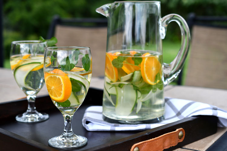 Infused spa water - cucumber slices, oranges and orange mint in water. Drinks On A Tray Beverage Cucumber Cucumbers Detox Drink More Water Hydration Citrus Fruit Cucumber Water Dehydration Drink Drinking Glass Food And Drink Freshness Fruit In Hand Health Spa Healthy Healthy Beverage Infused Water Mint Oranges Pitcher - Jug Refreshment Spa SPA Water
