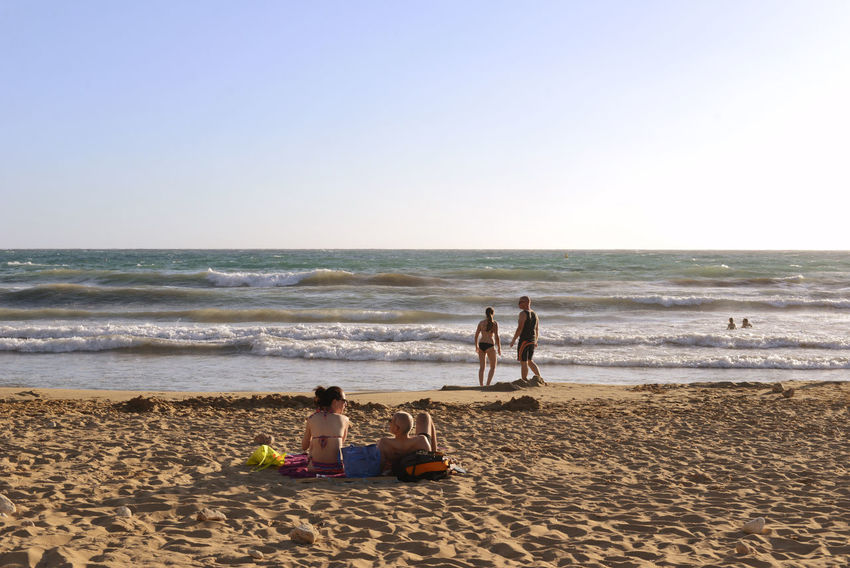 Malta Sand Beach Summertime Travel Adult Adults Only Beach Clear Sky Day Full Length Golden Bay Horizon Horizon Over Water Leisure Activity Men Nature Outdoors People Sand Sea Sitting Sky Summer Togetherness Turism Vacations Water Water's Edge Wave Weekend Activities Young Adult