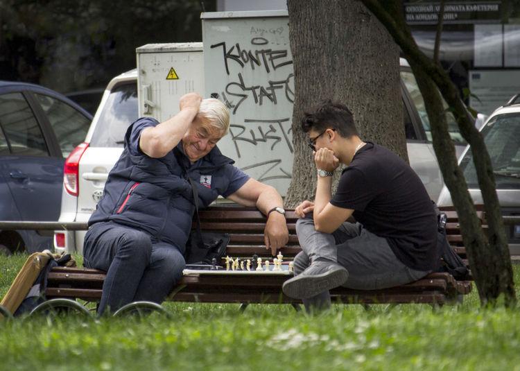 Men sitting in park