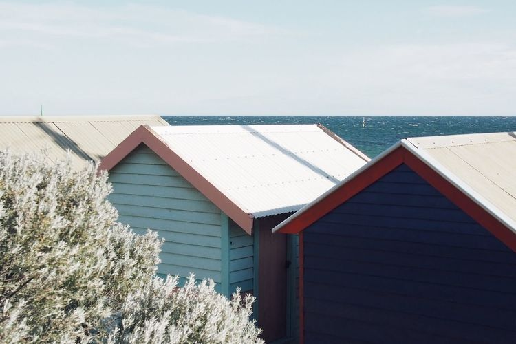 Snow covered cabins on beach