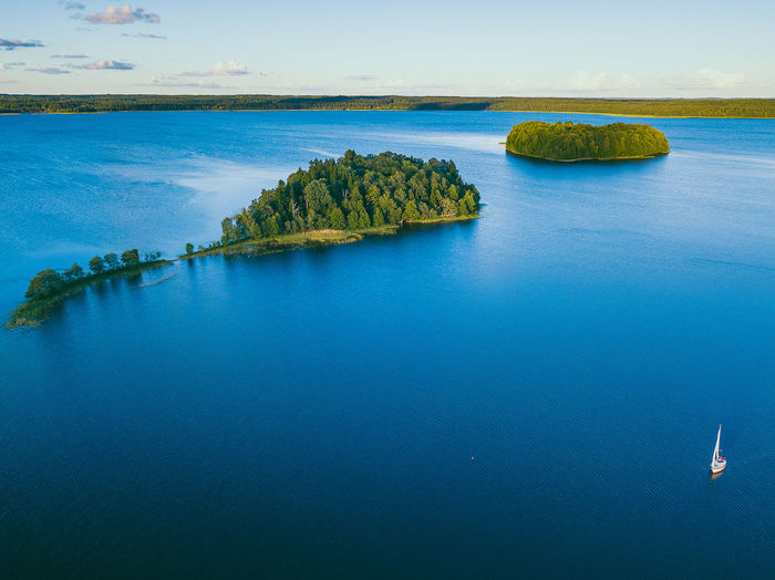 Islands, Plateliai lake Aerial Shot Drone  Lietuva Lithuania Nature Sailing Ship Travel Aerial Aerial View Beauty In Nature Blue Day Drone Photography Europe Horizon Horizon Over Water Idyllic Mavic Mavic Pro Nature No People Non-urban Scene Outdoors Rock Sailing Sailing Boat Scenics - Nature Sea Sky Solid Tranquil Scene Tranquility Turquoise Colored Water Waterfront