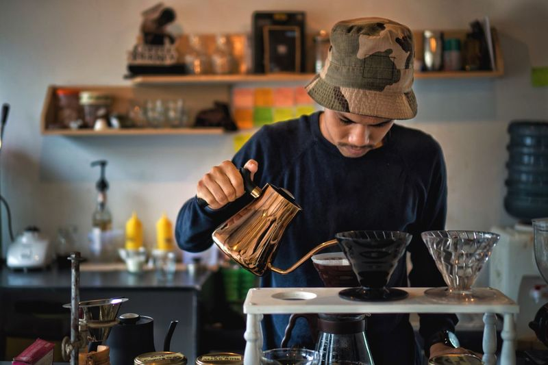 Making the world better Pour Over Barista Aceh Coffee Food And Drink Drink Indoors  One Person Bar - Drink Establishment Refreshment Happy Hour The Modern Professional