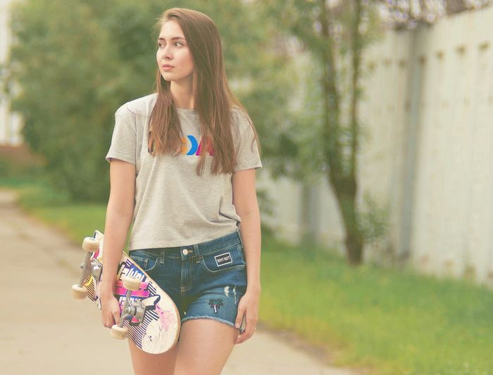 Young woman standing on road