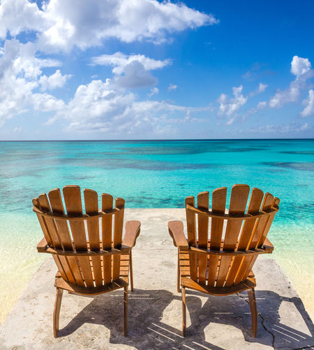💭Not a bad spot to spend the day💭~ Sea Beach Chair Blue Vacations Relaxation Sand Tropical Climate Travel Destinations Travel Idyllic Beauty In Nature Sunlight Sky Tourism Outdoors Water Paradise Grandturk Turksandcaicos Coastline