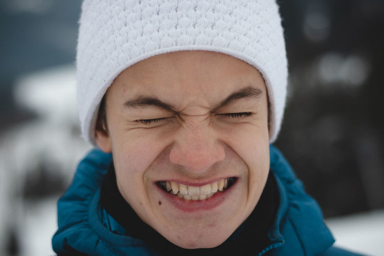 Portrait of smiling boy in park during winter