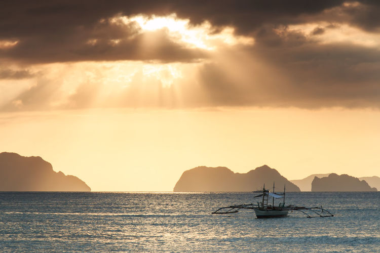 Outrigger In Sea At Dusk