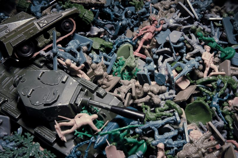 High angle view of figurines and armored tank